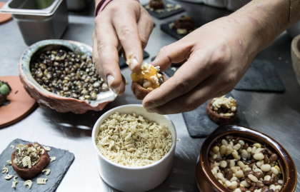 Photo of chef's hands preparing ingredients for indigenous thanksgiving meal.