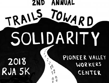 Black-and-white event T-shirt design showing a trail with footprints leading into the mountains