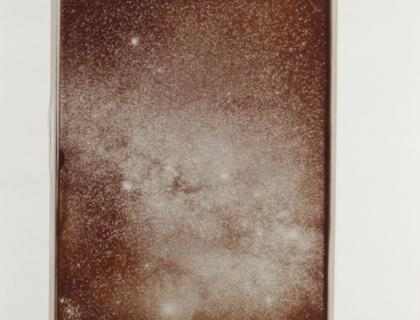Sepia-toned photo of thousands of stars in the sky
