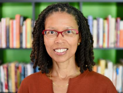 Headshot of Evie Shockley in front of a bookshelf