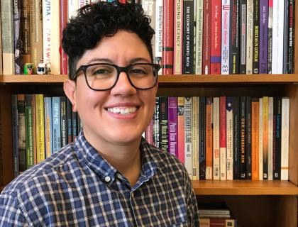 Marisol Lebrón in front of a bookshelf, smiling