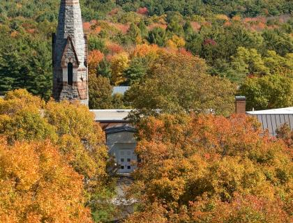 Stearns Steeple in front of the Mead Art Museum. Trees are full of rich fall colors.