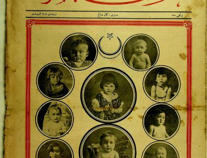 Yellowed page with photos of small children