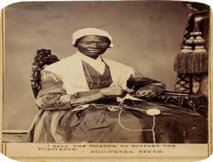 """Sepia-toned portrait of Sojourner Truth seated with a ball of yarn and knitting needles; at the bottom is a quote from her: """"I sell the shadow to support the substance."""""""