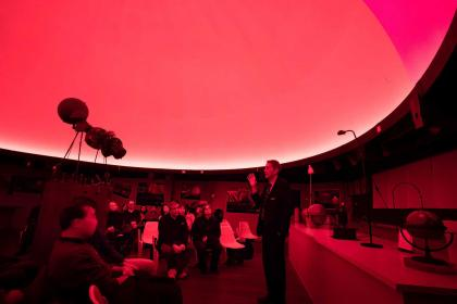 Alfred Venne, the planetarium director, speaks in Bassett Planetarium, a place that has helped generations of students and faculty to better understand their place in the universe.