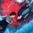 Movie poster showing an overhead view of a woman and man lying down on an icy surface through which a red heart is visible