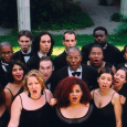 Nathaniel Dett Chorale standing together and singing outdoors, wearing black dresses and suits