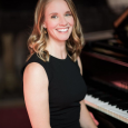 Composer Jen Allen sitting at a piano
