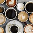 An array of coffee mugs filled with coffee, tea, and lattes.