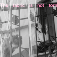 "Black-and-white image of two women on a staircase with a translucent curtain hanging over part of it. Across the top of the image are the words ""The fabric is not torn"" in pink."