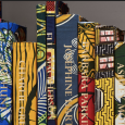 A row of books covered in brightly patterned fabric