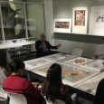 Mead Director David E. Little in the study room looking at prints with students enrolled in Collecting 101.
