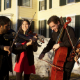 Half of Mendelssohn Octet, performing outdoors on campus