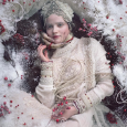 Movie poster showing a person dressed in white, lying on the ground amid snow and red berries