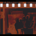Piece of film, showing a negative image of five people