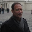 Closeup of Amir Weiner outdoors, wearing a black coat and gray scarf