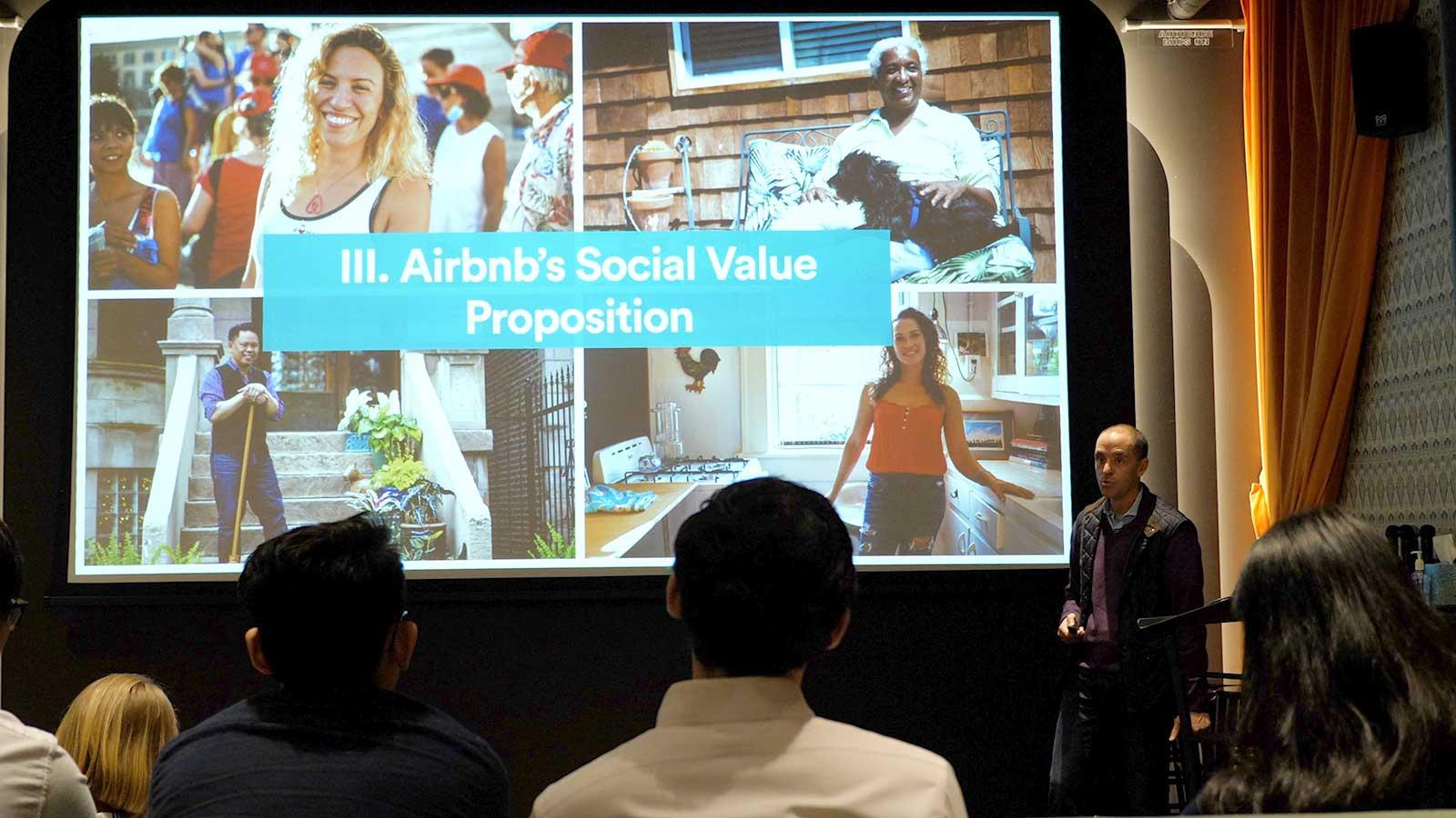 Chris Lehane '90 giving a presentation about Airbnb