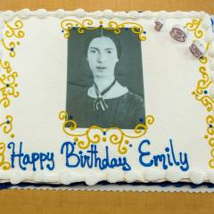Cake decorated with a black-and-white portrait of Emily Dickinson and the words