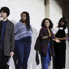 Last year's poetry slam winners with host Daniel Gallant