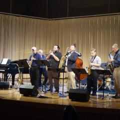 Amherst College jazz faculty playing instruments onstage in Buckley Recital Hall
