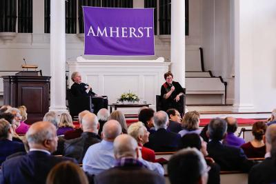 Photo of Board Chair Cullen Murphy '74 and President Martin speaking in Johnson Chapel