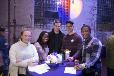 five students posing for the camera during a party at the Power House