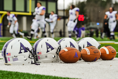 footballs and helmets