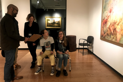 Photograph of an Amherst College professor and the Mead Art Museum's Head of Education with three students teaching and learning in the galleries of the Mead.