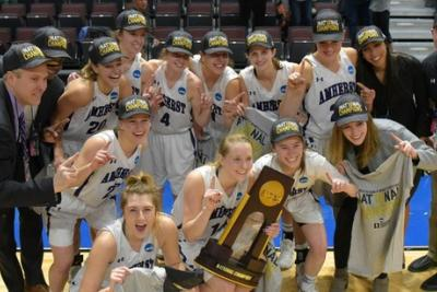 Amherst College women's basketball team posing with their trophy after winning a national championship