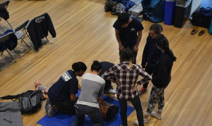 ACEMS members practicing CPR