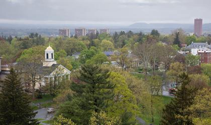 An arial photo of downtown Amherst on a misty spring day