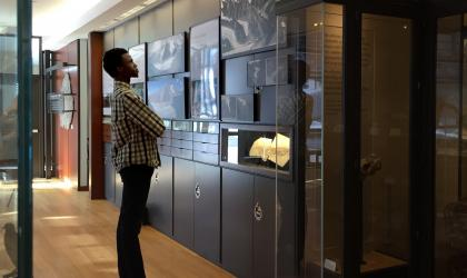 Student observing a museum exhibit