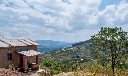 A stone house and terraced farm hills