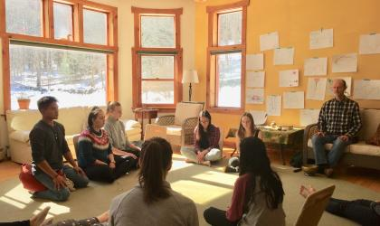 A group of students in a circle practicing meditation