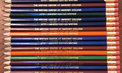 stack of pencils in many colors with text inscribed: