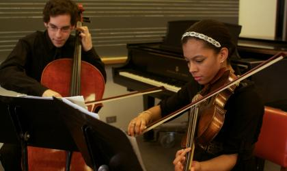 two-students-performing-music