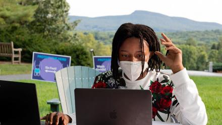 An Amherst College student studying outside during the pandemic.