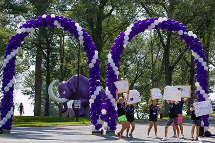 Cars entering the campus were greeted by this cheer squad and the Mammoth mascot.