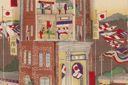 art of assorted flags displayed on a brick building