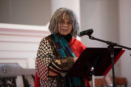 Sonia Sanchez at a podium in Johnson Chapel, delivering the keynote address at the second annual Dr. Martin Luther King Legacy Symposium.