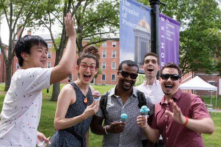 five smiling alumni holding ice cream at reunion
