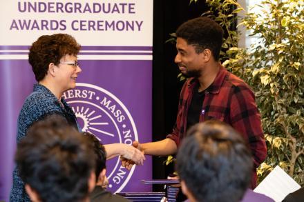 President Biddy Martin shakes hands with an award recipient