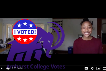 Maya Foster '23 with an I Voted Mammoth sticker