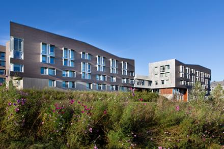 The Greenway dorms under a bright blue sky