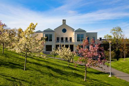 campus center with flowering trees in front