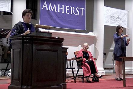 Biddy Martin speaking at the podium at Convocation 2017, Amherst College.
