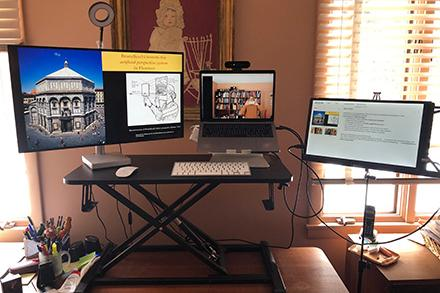 Computer desk set up with four monitors