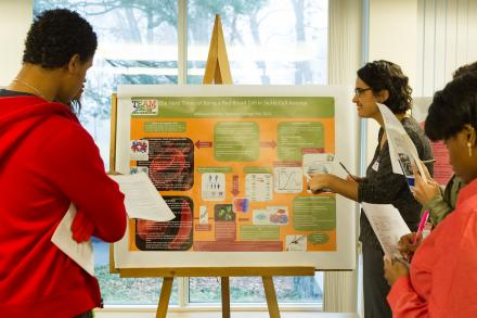 Professor Jaswal with a student presenting her project