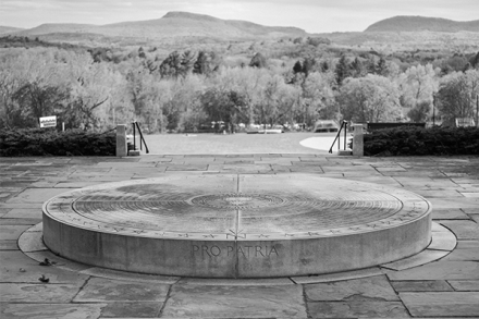A black and white photo of the war memorial with Mount Holyoke in the distance