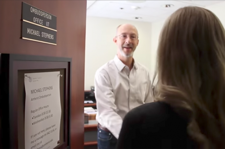 Michael Stephens, the Ombudsperson, welcomes an employee into his office